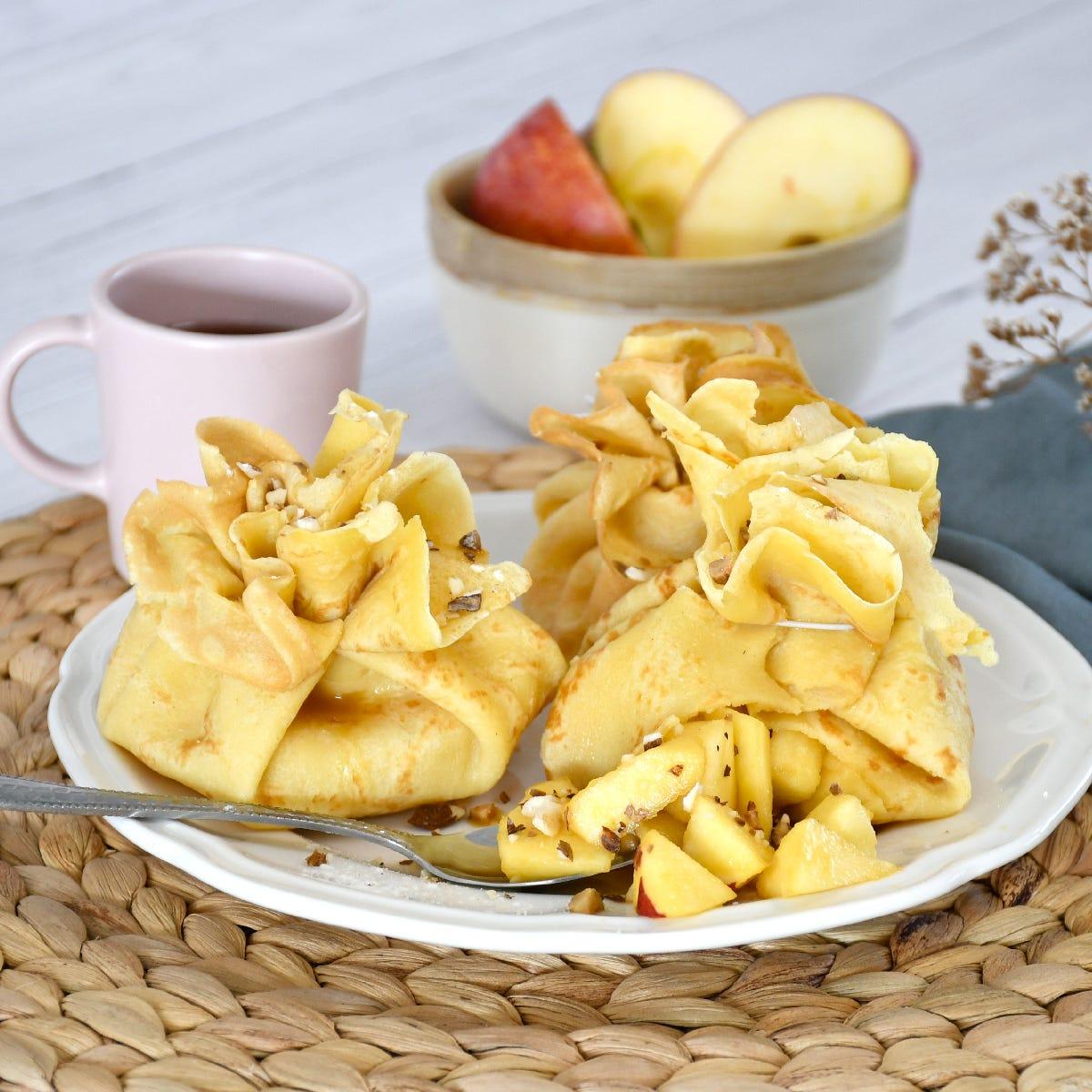 ¡Ponle magia a la merienda con esta original receta de saquitos de crepes de manzana y caramelo!
